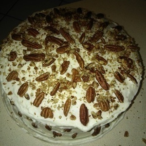 from scratch banana cake almond with cream frostingwith pecan pieces